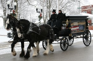 A horse-drawn hearse carrying the flag-covered casket of Edd Kueker makes its way up Main Street from Immanuel Lutheran Church to Kolmer Memorial Cemetery in Waterloo on Saturday morning. (Kermit Constantine photo)