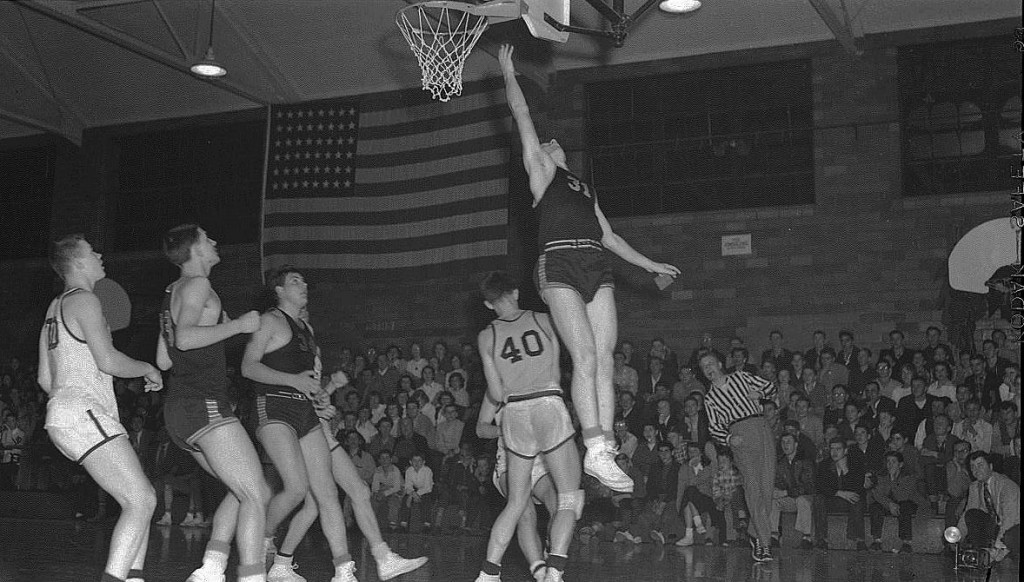 This is the first sports action photo ever taken by the late, longtime Republic-Times editor Bob Voris, that of Sonny West scoring on a layup for Waterloo High School as they defeated Belleville for the regional hoops title in 1952.