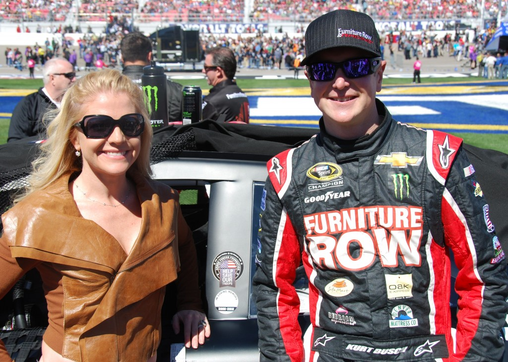 Pictured, from left, Armed Forces Foundation President Patricia Driscoll and NASCAR racer Kurt Busch display the logo honoring Columbia's Robert Holden before Sunday's race.  (submitted photo)