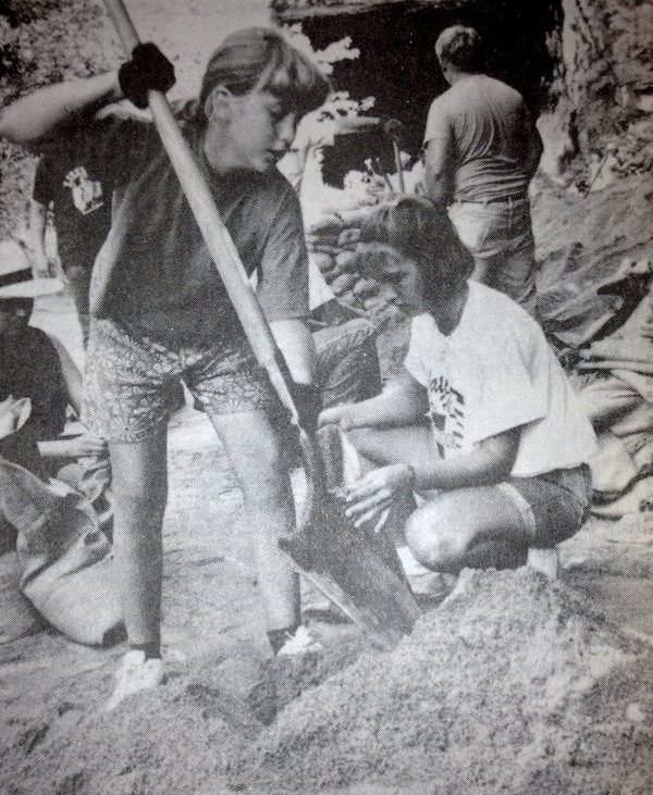 This is a photo that appeared in the July 21, 1993, edition of the Republic-Times, as the rising Mississippi River was beginning to cause serious flooding issues in the American Bottom -- including sand boils throughout the levee system. Pictured, Megan Schneider, 11, of Valmeyer, and Danielle Patton, 14, of Waterloo, help fill sandbags at the Valmeyer quarry. The Aug. 7 edition of the Republic-Times will feature the second of three articles looking back on the Flood of 1993. The first feature ran in the July 17 edition. (Marvin Cortner photo)