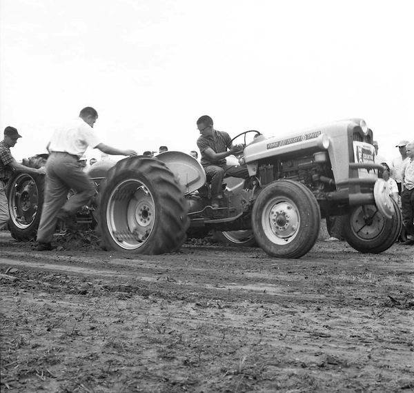 Pictured is a Monroe County Fair tractor pull in 1965, when they used man-weighted sleds during competition -- a stark contrast from today's motorized sleds. If you can help us name those in the photo, email us at news@republictimes.net. (Bob Voris photo)