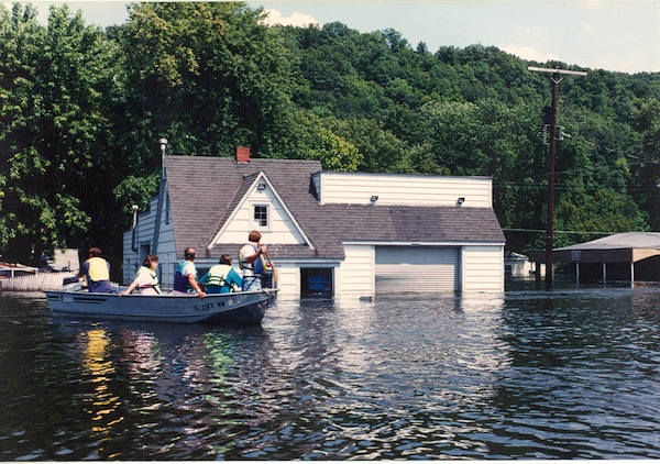The U.S. Coast Guard took owners into the flooded town of Valmeyer to look at their property in early August. Pictured, residents pass Mike and Laurie Brown's gas station and auto repair shop, located on the east side of town. More photos of the flood are on page 6A. (Photo courtesy of Dennis Knobloch)