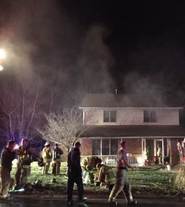 Pictured, Columbia firefighters work to extinguish a fire and ventilate smoke Tuesday night at a home on Oak Tree Drive. (Corey Saathoff photo)