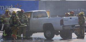 The Waterloo Fire Department quickly doused the flames exuding from Smith's truck in the Waterloo parking lot. (Sean McGowan photo)