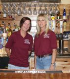 Pictured, from left, are Back Street Wine & Dine co-owners Robbin Layton and Kim Koesterer. They received help from friends and family in designing the bar, and Koesterer designed the wine racks behind the bar. (Sean McGowan photo)
