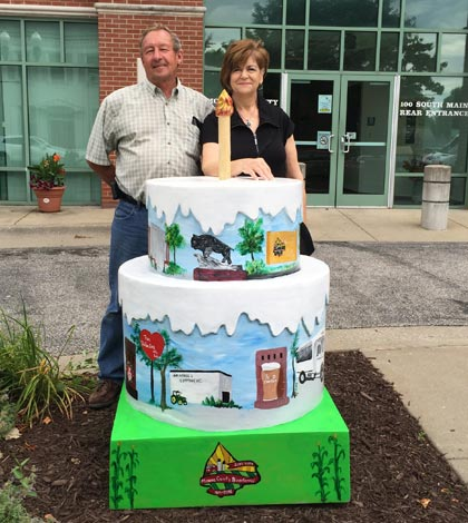 Monroe County Commissioner Delbert Wittenauer and artist Mary Biby stand by the first of two fiberglass cakes that will be on display as part of the Monroe County Bicentennial.