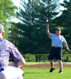 Bob Mohr throws out the ceremonial first pitch prior to Thursday's Valmeyer Junior Legion baseball game at Borsch Park. (Corey Saathoff photo)