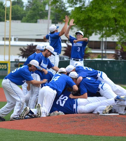 Freeburg players celebrate following a 9-6 win in the sectional title game over Waterloo. (Corey Saathoff photo)