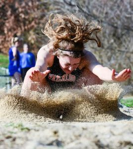 This photo taken by John Spytek of Waterloo High School's Hannah Finnerty landing a long jump in the sand during the 2015 track season won the Illinois Press Association award for Best Sports Photo on Friday.