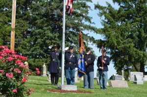 Members of the Friedrich K. Hecker Camp 443 Sons of Union Veterans of the Civil War stand guard during the playing of our National Anthem at St. Augustine Cemetery in Hecker.