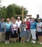 Pictured with Michael Rebholz are individuals representing organizations who assisted with the Potter's Field project, from left, Ralph Axe, who made the cross with his son Jeff; Norma Reheis, president of the Monroe County History Museum; Rebholz; Barb Buchanan of Whiteside Station Chapter Daughters of the American Revolution; Waterloo Mayor Tom Smith; Sue Watters and Florence Mulligan of DAR; Rev. James Watson of St. Paul United Church of Christ in Waterloo, Pat Vaseska of DAR and the Monroe County Genealogy Society; Father Osang Idagbo of Ss. Peter & Paul Catholic Parish; and Rev. Thelma Burgonio-Watson of the House of Neighborly Service. (Andrea Saathoff photo)
