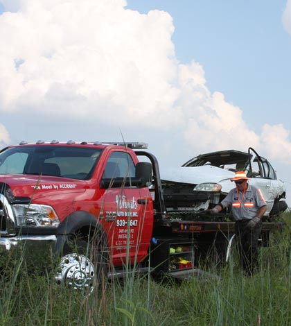 Pictured is the vehicle involved in the crash being loaded onto a Wheat's Towing truck. (Sean McGowan photo)