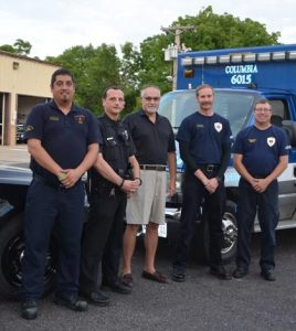 Pictured with heart attack survivor Dave Altvater (center), from left, are Anthony Perez of Columbia EMS, Columbia police officer Ryan Doetsch, and Brandon Layton and Tim May of Columbia EMS. (Corey Saathoff photo)