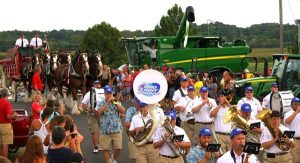 "Pictured, the Bud Light Brigade leads the Budweiser Clydesdale hitch in a parade around the fairgrounds Thursday night, beginning with a rousing rendition of ""Here Comes the King."" (Kermit Constantine photo)"