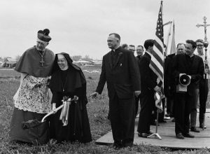 The Gibault Catholic High School groundbreaking took place in April 1966 at the current school grounds. Pictured, from left, after Most Rev. Albert R. Zuroweste, bishop of the Belleville Diocese, blessed the ground, he and Sister Angelita Myerscough break ground while Monsignor Elmer Holtgrave watches and Father Ed Hustedde looks on. (Republican archive photo)