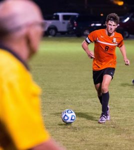 Waterloo's Ben Huels pushes the ball forward during a recent game. (Alan Dooley photo)