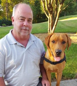 Dave Eustis recently brought home a service dog named Zeke to help him with is handicap. (submitted photo)