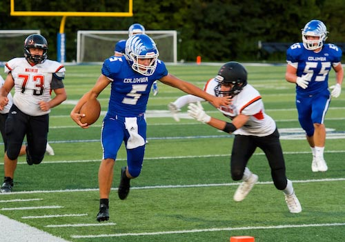 Columbia quarterback Greg Long eludes Waterloo defenders during a scramble near the endzone on Friday night. Long is this week's R-T Athlete of the Week for his performance last Friday. For more photos from the game, click here. (Alan Dooley photo)