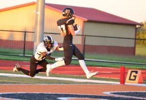 Senior wide receiver Kyle Knefelkamp evades a Carbondale defender to find the end zone.
