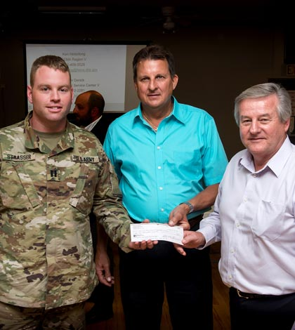 U.S. Army Capt. Dan Strasser, representing the Army Corps of Engineers, was presented a check for $62,000 by Prairie du Rocher Levee District President Steven Gonzalez and Prairie du Rocher Village President Raymond Cole during a meeting to discuss the levee process on Wednesday. The money will be used to pay the Corps to complete a survey of the levee that will hopefully lead to its certification.  (Alan Dooley photo)
