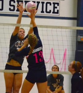 Waterloo's Kat Finnerty goes up to block an attempt by Gibault's Lexi Chambers during Thursday's match.