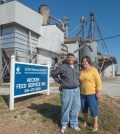 Gary and Joan Wittenauer pose in front of Hecker Feed Service, which they have reluctantly ended after 60 years and two generations of supporting farming in the region. (Alan Dooley photo)