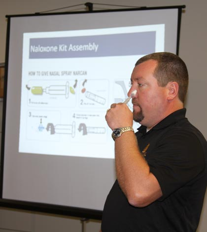 Pictured, Monroe County EMA Director Ryan Weber demonstrates how to administer Narcan during a training session for local first responders. (Sean McGowan photo)