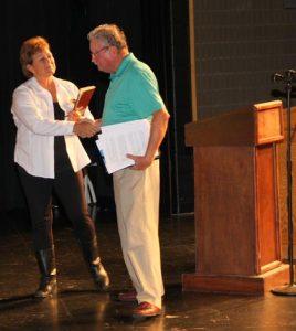 Monroe County Board candidates Vicki Koerber and Leo Stephan shake hands following their debate Thursday night.