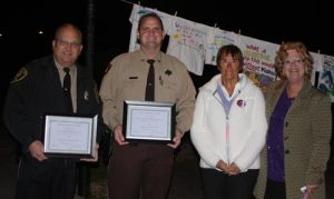 Pictured, from left, peacekeeper award recipients Waterloo Police Chief Jim Trantham and Monroe County Sheriff's Department Deputy Chad Mueller celebrate with Kay Clements of the Violence Prevention Center in Monroe County and Monroe County Circuit Clerk Sandy Sauget, who helped coordinate Thursday's Peace Walk in Valmeyer. (Sean McGowan photo)