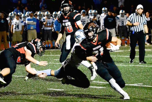 Waterloo's Scott Nanney runs the ball in overtime on Friday night. He would later score the winning touchdown. (John Spytek photo)
