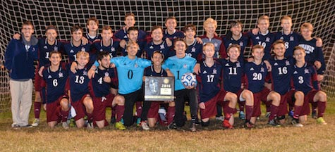 The Gibault soccer team poses with its sectional championship plaque following Friday's win over Althoff. (John Spytek photo)