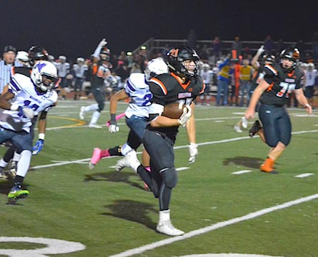 Waterloo running back Scott Nanney turns on the jets for a 45-yard touchdown run to start the fourth quarter on Friday night. (Corey Saathoff photo)