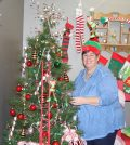 Jan Dudley proudly displays the Elf Land area that kids will see at this year's Christmas Tree Walk. (Sean McGowan photo)