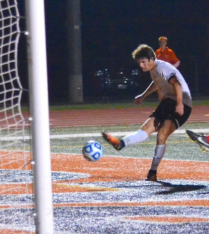 Waterloo's Ben Huels attempts a shot on goal during Friday's sectional final against Jacksonville. (Corey Saathoff photo)