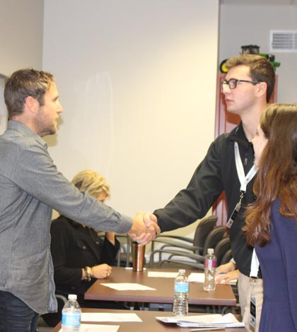 Pictured, Matt Heck, co-owner of Nutshellz, introduces himself to CEO students JD Steibel and Maya Speckhard. (submitted photo)