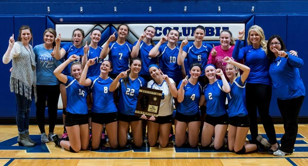 The Columbia High School volleyball team celebrates its regional championship win at home against Waterloo last month. (Alan Dooley photo)
