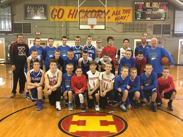 Pictured, players and coaches from the Columbia Middle School and Knightstown basketball teams gather on the court inside the historic Hoosier Gym. (submitted photo)
