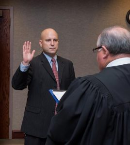 Pictured, Chris Hitzemann is sworn in Dec. 1 as Monroe County State's Attorney by Circuit Judge Dennis Doyle.