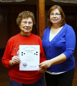 Waterloo VFW Auxiliary President Carol Schilling presents Florence Feldmeier with a voluntary service certificate for her volunteer efforts with the Jefferson Barracks Veterans Affairs Medical Center in St. Louis. (Kermit Constantine photo)