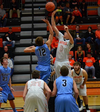 Pictured at right, Waterloo's Dylan Hunt jumps for the ball at the start of the game against Jerseyville on Dec. 2. (John Spytek photo)