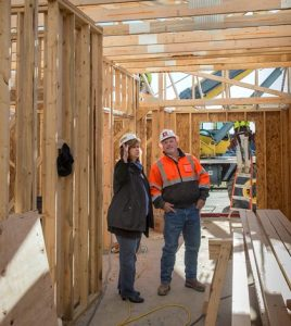 Oak Hill Director Kim Keckritz listens as Holland Construction's Roger Kinzinger explains how interior walls and ceilings will be placed at Evergreen Pointe.