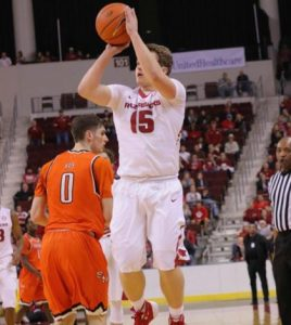 Columbia High School graduate Jonny Holmes shoots the ball for the University of Arkansas during a recent game. (submitted photo)
