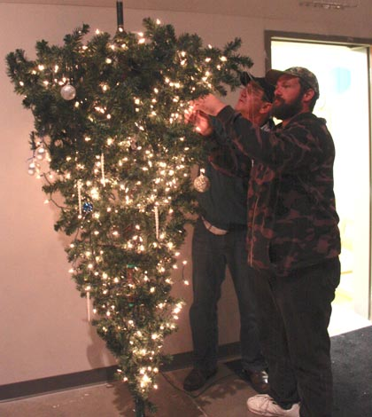 pictured from left dave dudley and brian offerman put the finishing touches on one of the trees on display at this years christmas tree walk at the